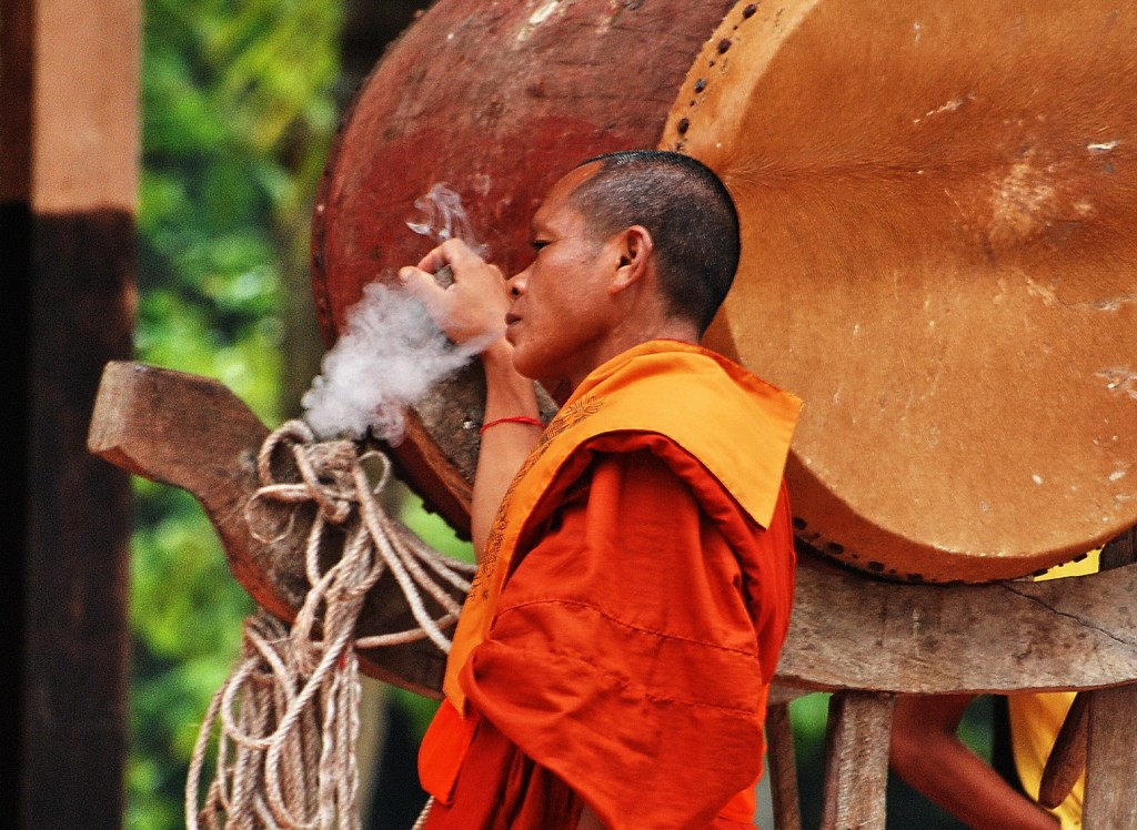 Cambodia, monk sneaking a puff!