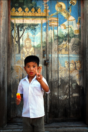 Kid and paintings