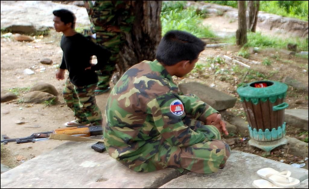Khmer soldier guarding rubbish bin at Preah Vihear