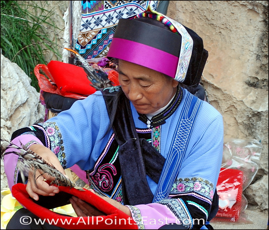 Stone Forest, Yi woman sewing