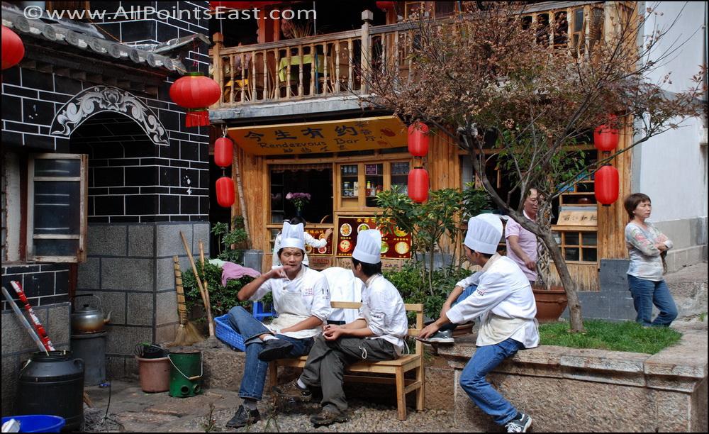 Chefs having a smoko outside a Lijiang restaurant