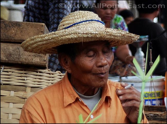 Old man at lakeside market at Inle