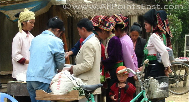 Tai women at a village market near Tuan Giao