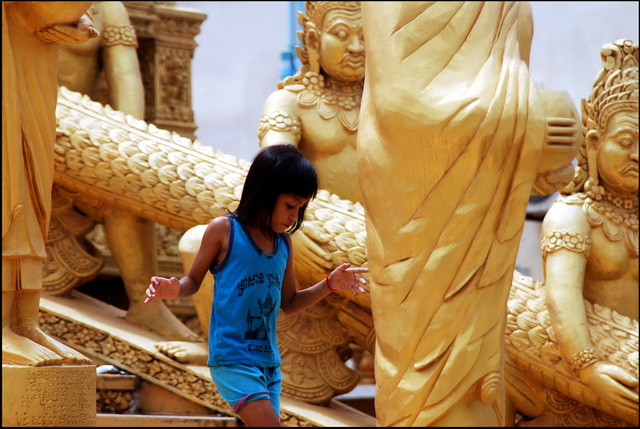 A favourite Phnom Penh Temple. Girl on the staircase
