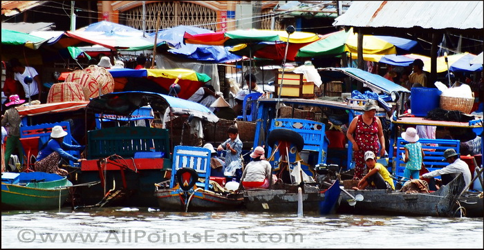 Boats arriving at the riverside market