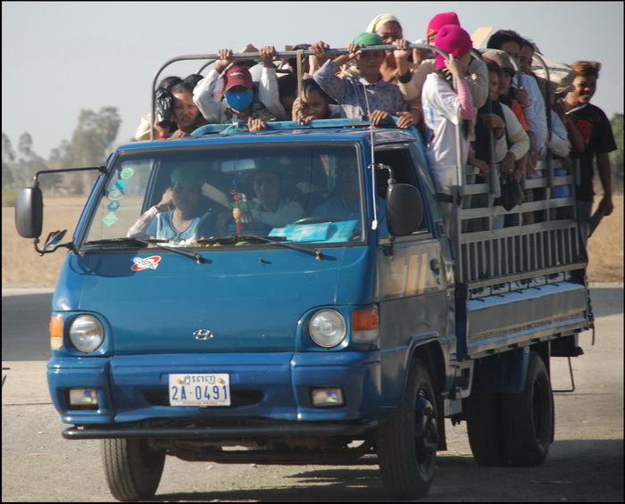 Public Transport Cambodia-style. Factory workers returning home, Kompong Speu