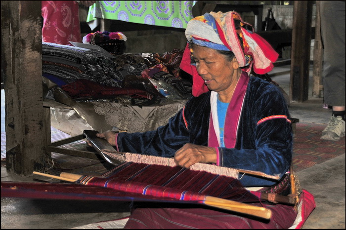 Demonstrating traditional weaving methods