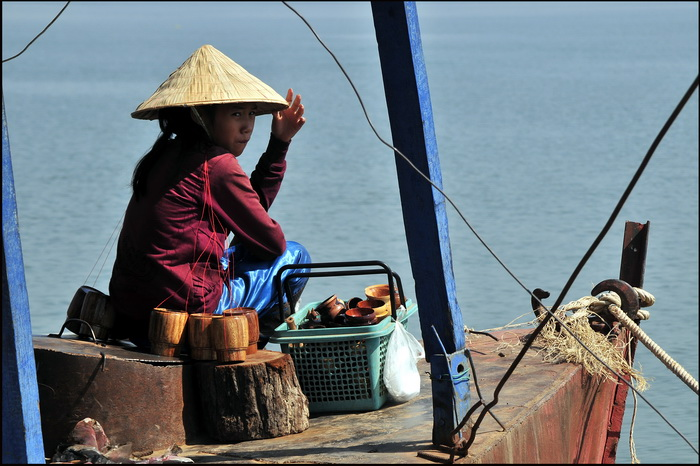Vietnamese vendor on the ferry to Ban Muang