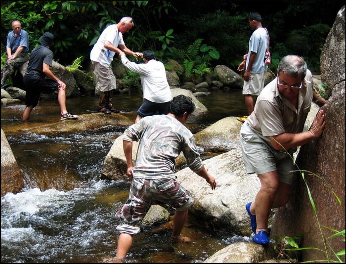 Crossing a stream during a trek in Nan