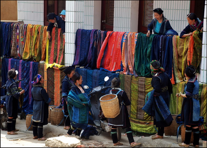 Colourful Hmong bed spreads lining the main street