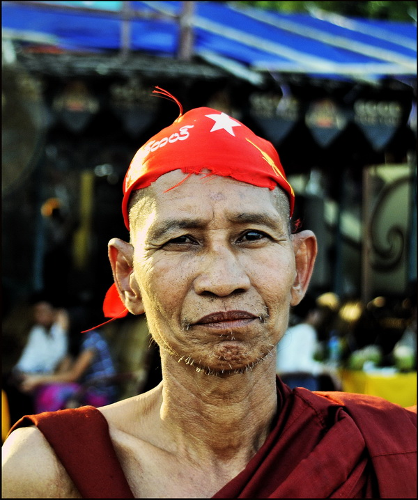 Monk at Amarapura proudly displaying his NLD bandana