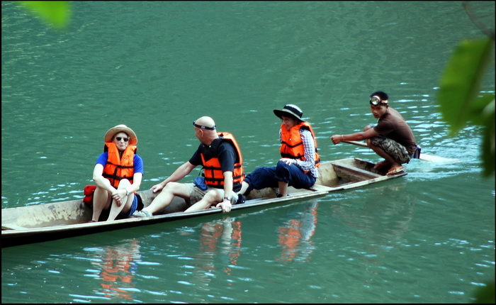 The motorized wooden canoes used in the cave