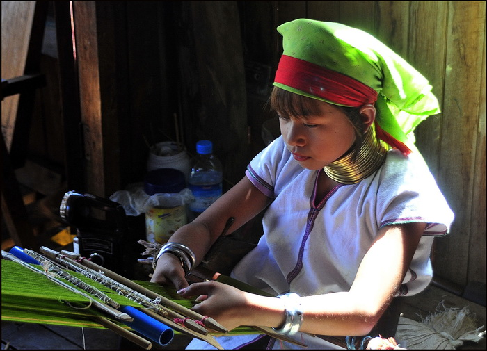 Padaung girl weaving, Inle lake