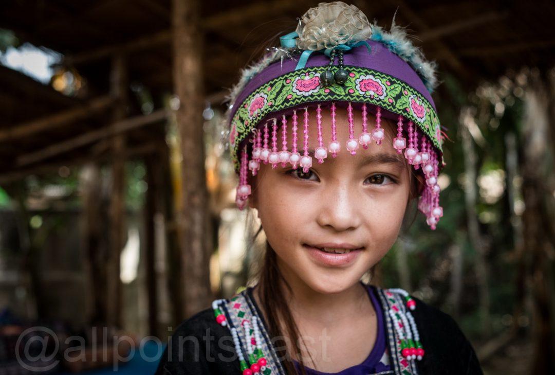 Laos photography tour, Akha girl in the market