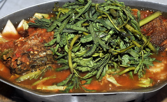 Whole fish in orange curry