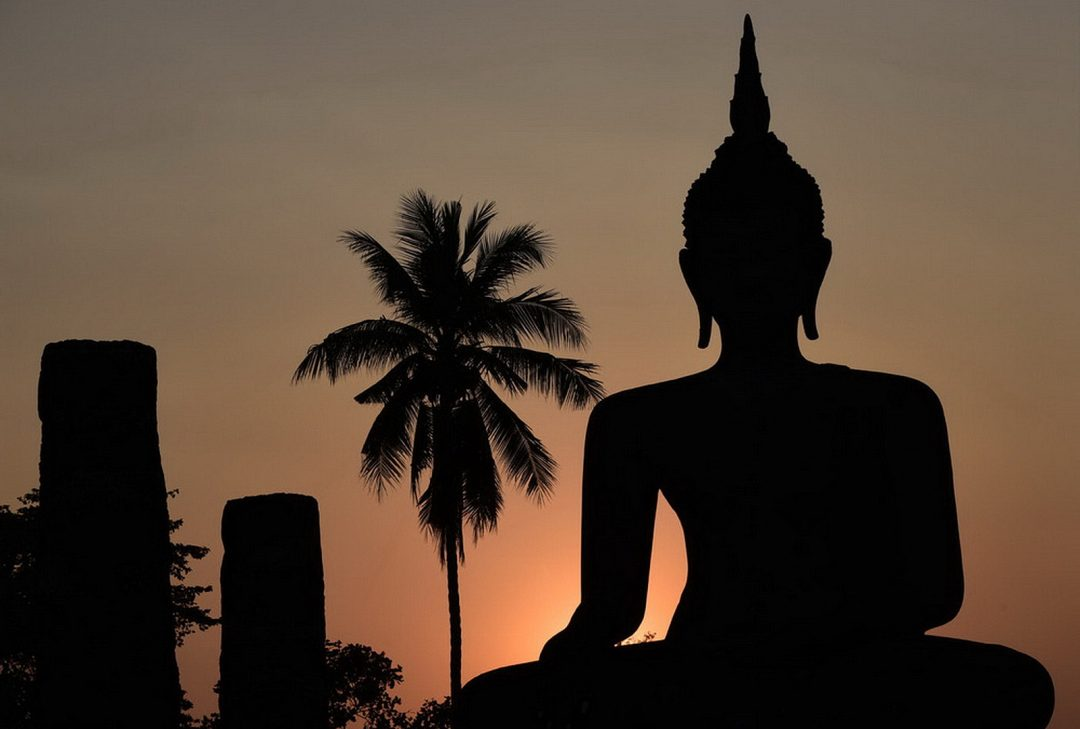 Thai Visas. Sukhothai Buddha at sunset