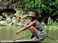 Boatman at sSadan Cave