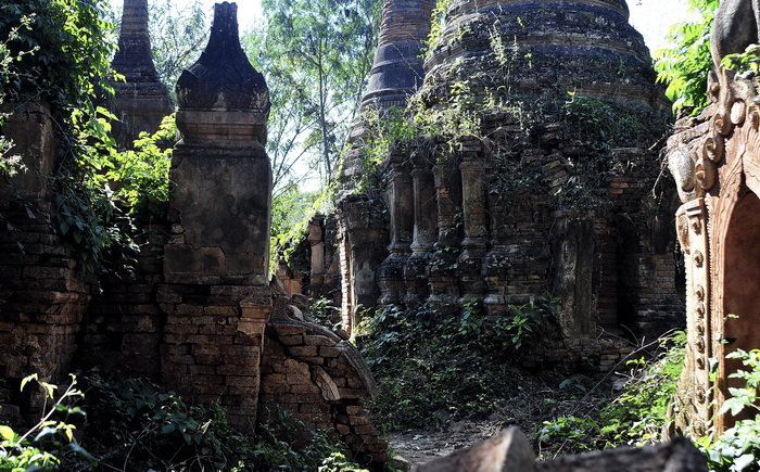 Unrestored stupas near the foot of the hill