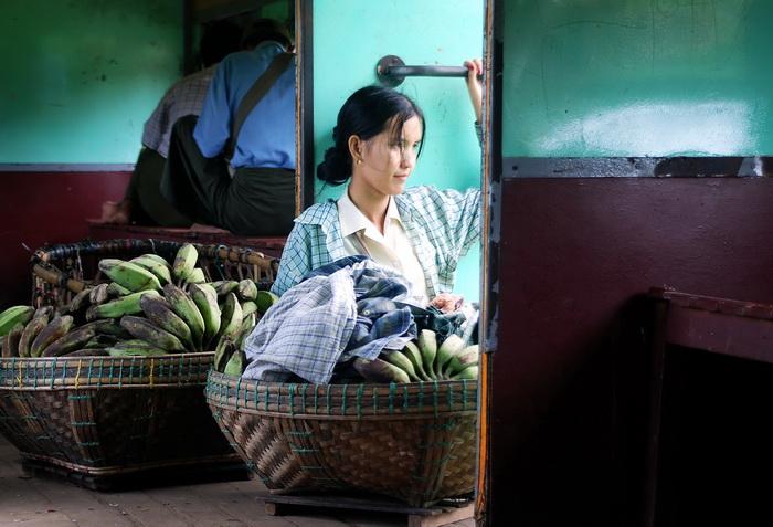 Pensive banana vendor off to market