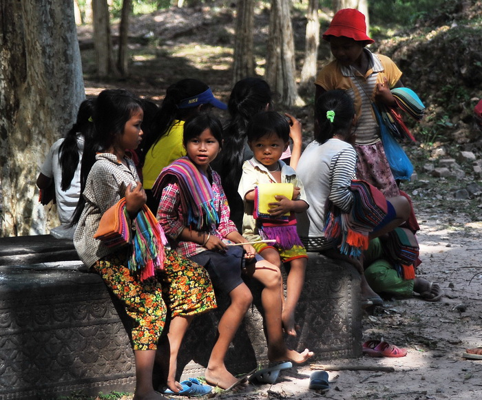 Kids selling Khmer scarves at Sambor Prei Kuk