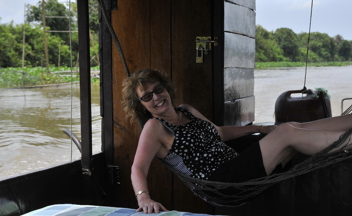Carole in hammock during boat trip to Battambang