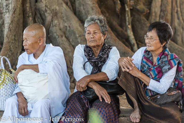 Elderly local women and a Buddhist nun take a break