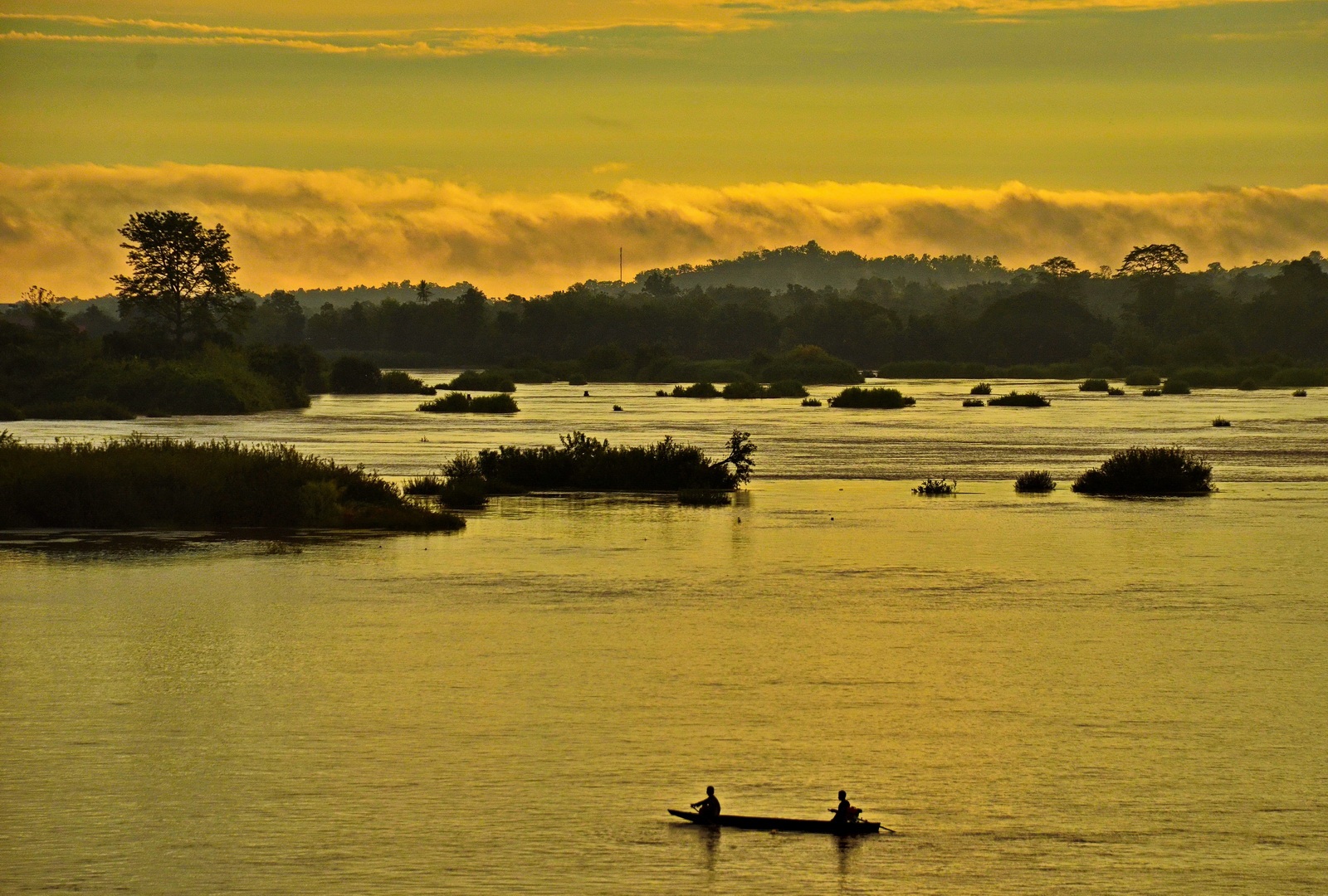 Laos, sunrise from our balcony on Done Khong