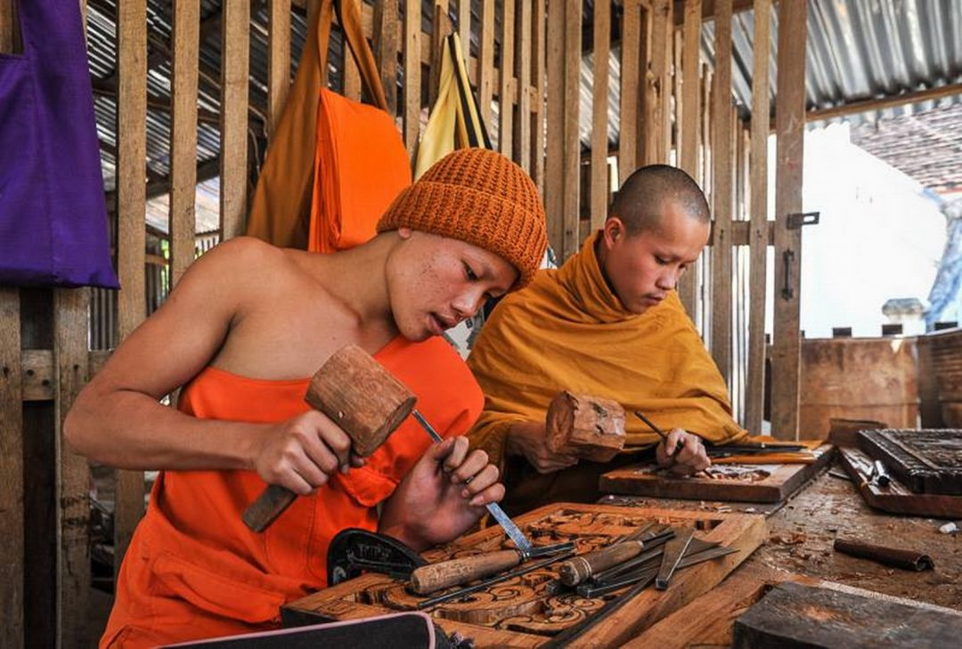Laos, carving, Luang Prabang, (by Jeff Perigois)