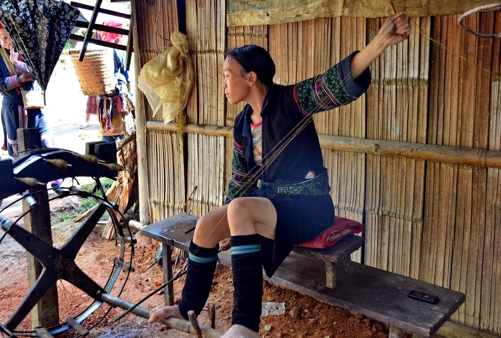 Black Hmong girl weaving hemp