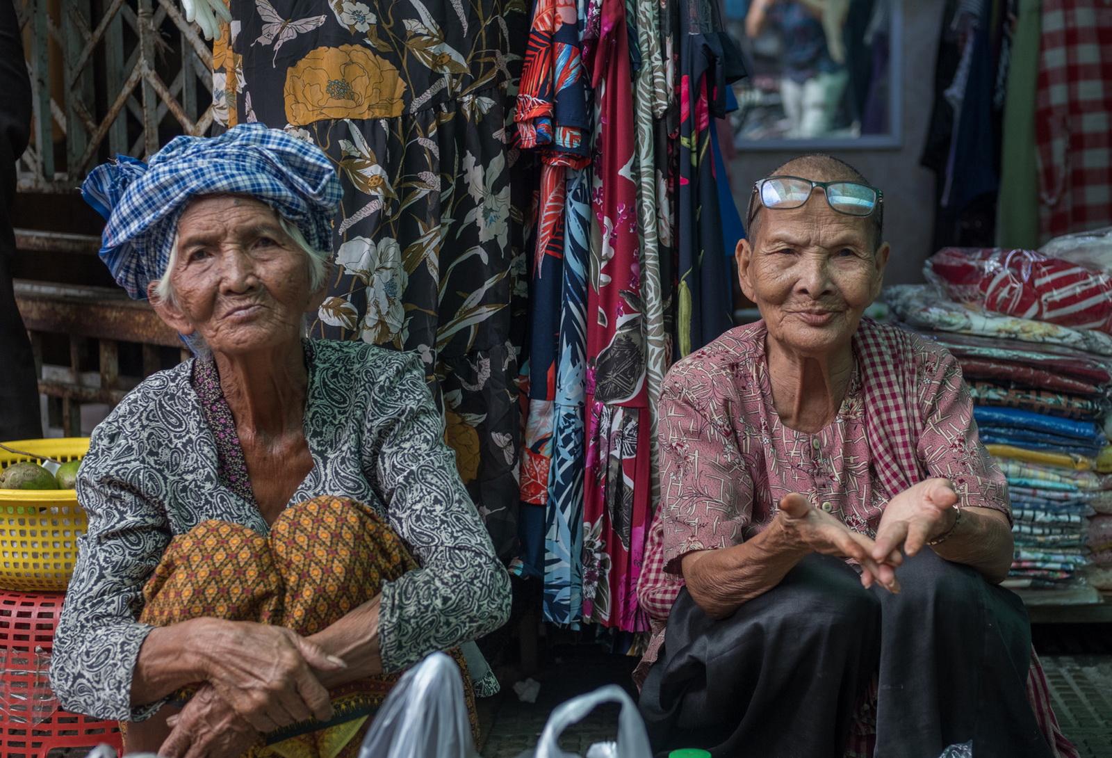 Cambodia Street Photography. Elderly market vendors by Jeff Perigois