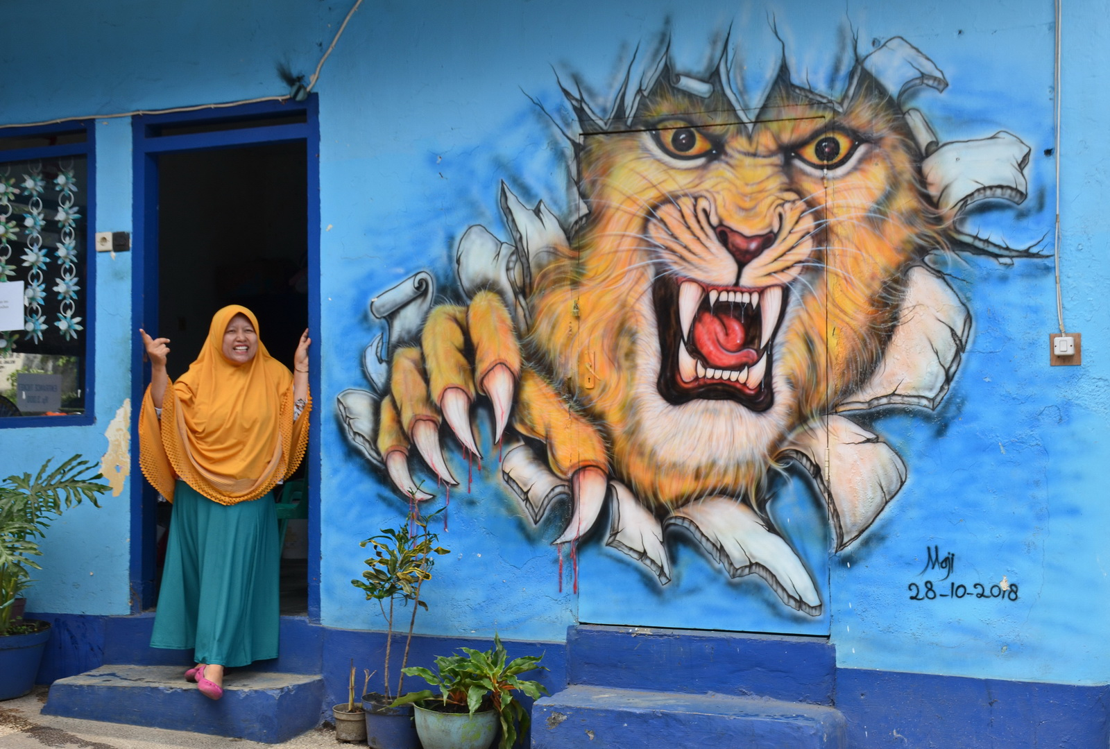 Malang's Rainbow Village, Indonesia. The local team, Arema FC's mascot being a lion