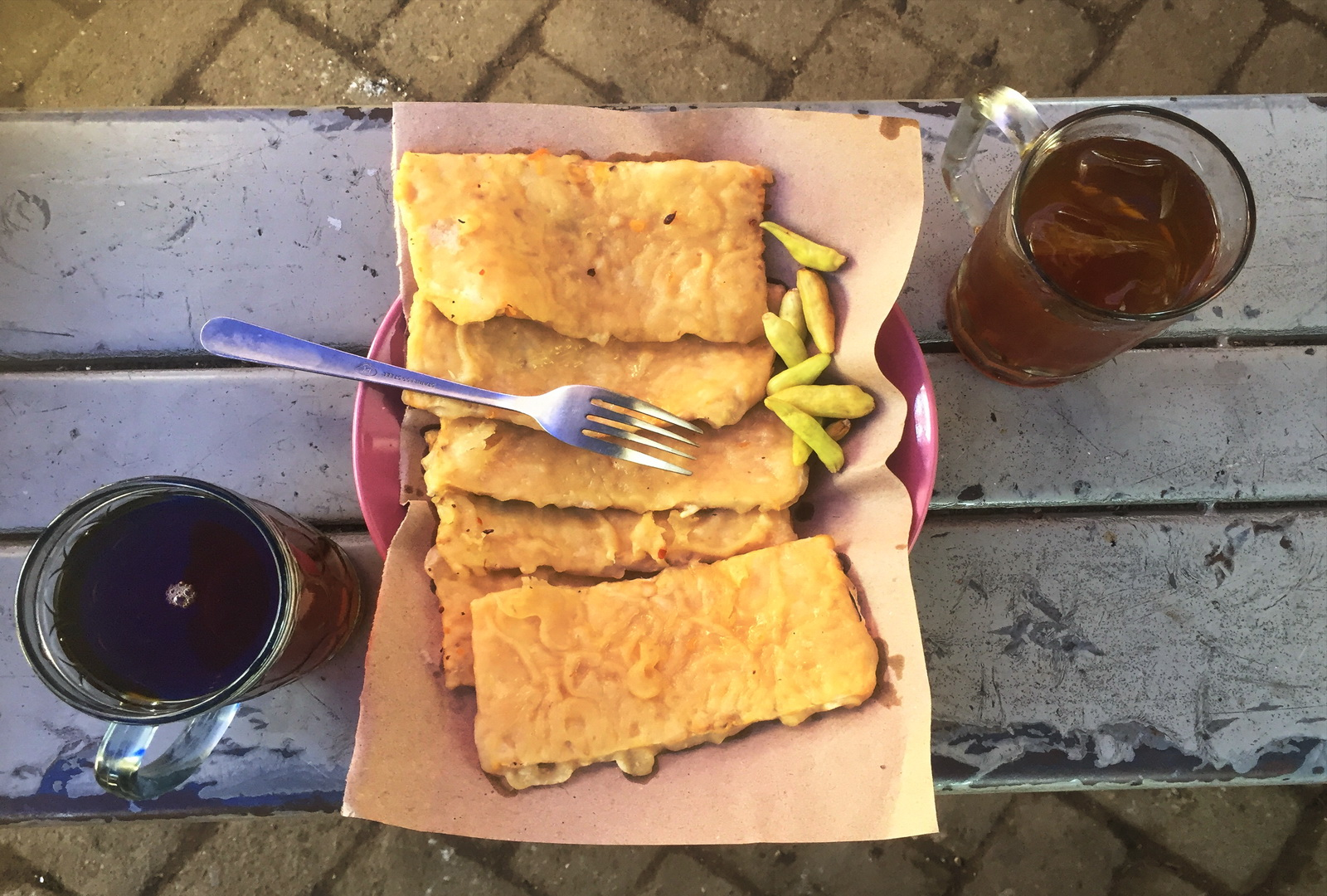Indonesia. Tea and tempeh in the local market, Solo.