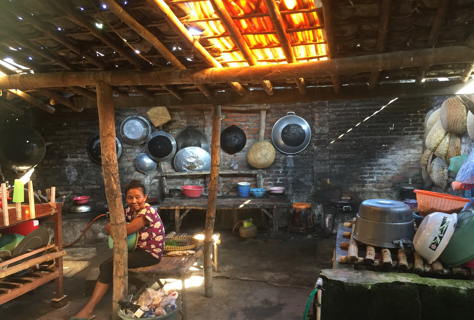 Indonesia. Traditional-style kitchen in a local cafe near Kilabaru