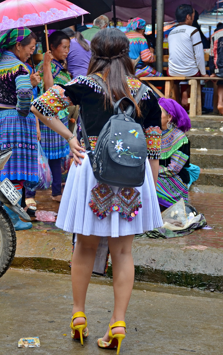 Vietnam. Traditional top, pleated miniskirt with Hmong flourishes and modern-style high heels.