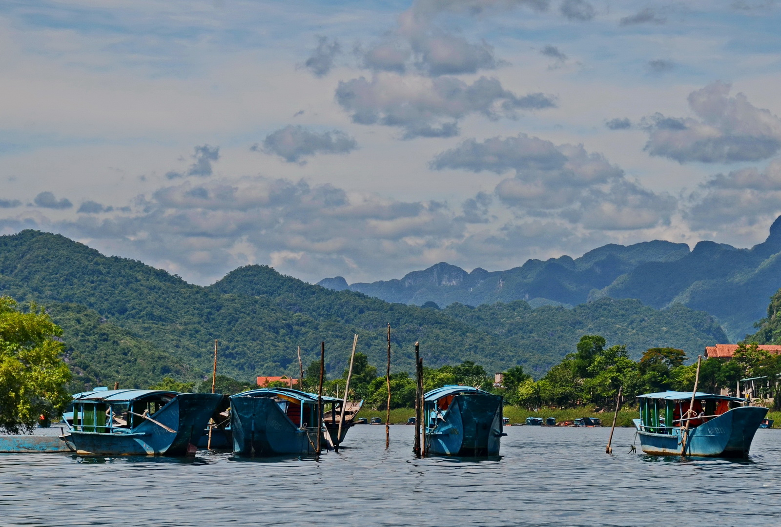 Vietnam, boats taking visitors up river to Phong Nha cave
