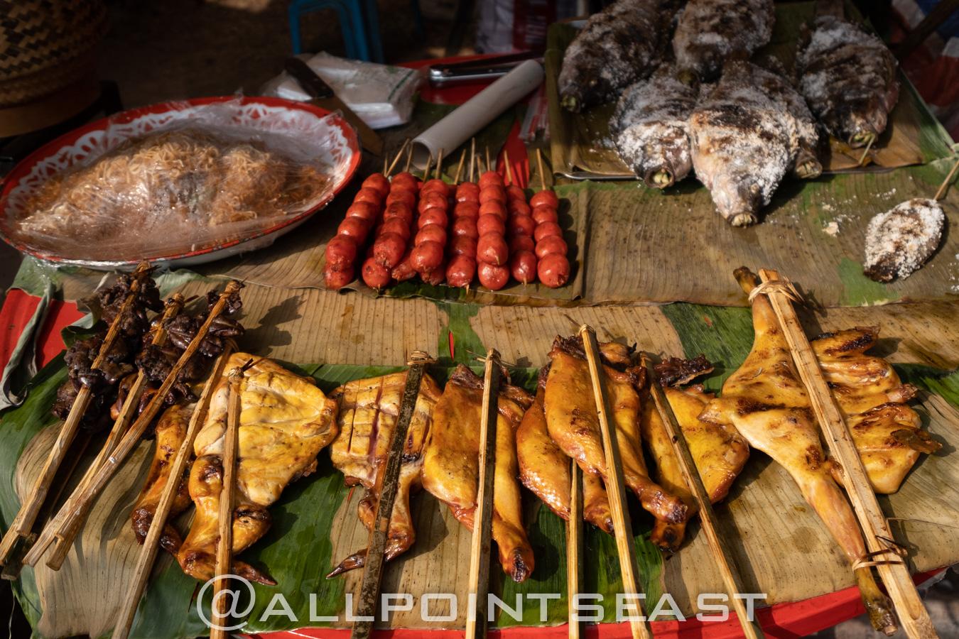 Laos, night market barbeque by Jeff Perigois