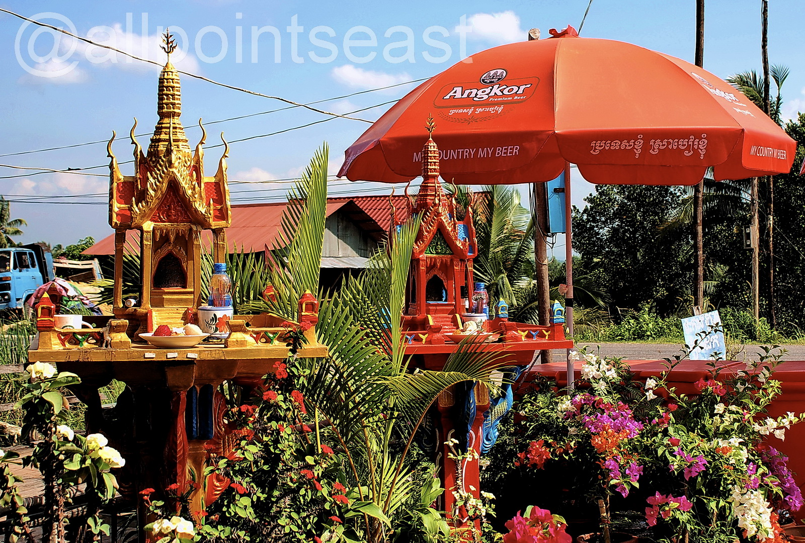 Colourful sprit shrines in front of a cafe, Koh Kong, Cambodia